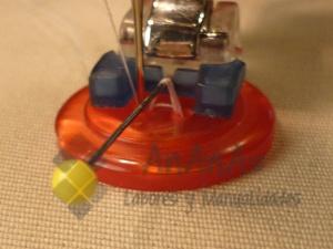 coser-boton