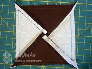 cuadrado-de-cuatro-triangulos-planchado-de-margenes-de-costura